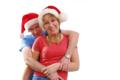 Young couple in santa hats royalty free stock photography
