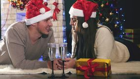 Young couple with Santa hats New Year 2017, Christmas stock footage