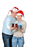 Young couple in Santa's hats Stock Image