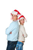 Young couple in Santa's hats Royalty Free Stock Images