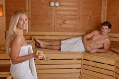 Young couple in sauna Stock Image