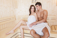 Young couple in the sauna Stock Photos