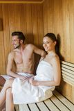 Young couple in the sauna Stock Images