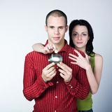Young couple saving Stock Images