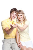 Young couple saving money Stock Images