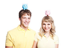 Young couple saving money Royalty Free Stock Images