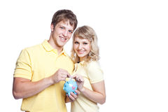 Young couple saving money Stock Photos