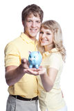 Young couple saving money Stock Photo