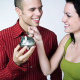 Young couple saving money Royalty Free Stock Photos