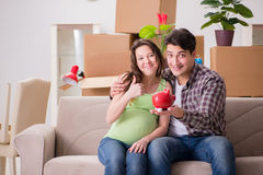 The young couple saving money for baby to be born Stock Image