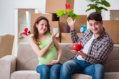 The young couple saving money for baby to be born Royalty Free Stock Photos