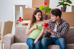 The young couple saving money for baby to be born Stock Images