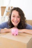 Young couple saving money in a piggy bank Stock Photo