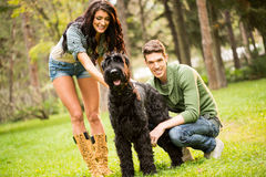 Young Couple With Schnauzer Royalty Free Stock Photos