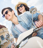 Young couple on scooter Stock Images