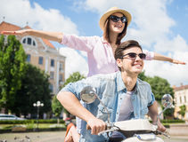Young couple on scooter Royalty Free Stock Images