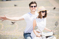 Young couple on scooter Stock Photography