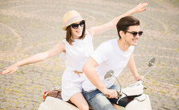 Young couple on scooter Royalty Free Stock Image