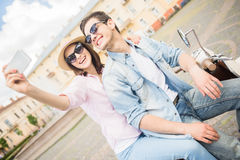 Young couple on scooter Stock Image