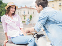Young couple on scooter Stock Photo