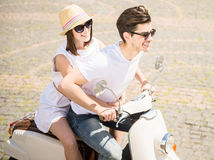 Young couple on scooter Royalty Free Stock Photography