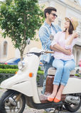 Young couple on scooter Stock Photos