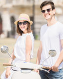 Young couple on scooter Royalty Free Stock Photos