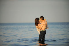 Young couple in the sea Royalty Free Stock Photography