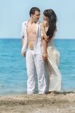 Young couple on sea background Royalty Free Stock Photography