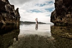 Young couple in the sea creek between the cliffs royalty free stock photos