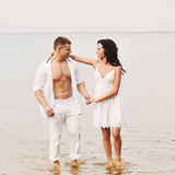Young couple in the sea Royalty Free Stock Photo