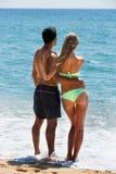 Young couple at sea shore Royalty Free Stock Image