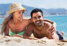 Young couple at sea shore Stock Photos