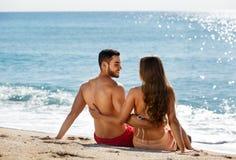 Young couple at sea shore Stock Photo