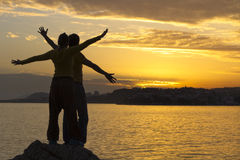 Young couple at sea sunset Stock Images