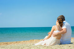 Young couple by the sea Stock Photos