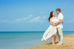 Young couple by the sea Royalty Free Stock Image