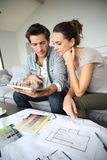 Young couple searching for ideas of decoration Royalty Free Stock Image