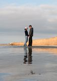 Young couple at the seashore royalty free stock photos