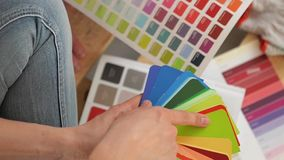 Young couple selecting a color for a condo, close-up stock video
