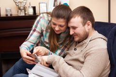 Young couple and self-portrait. Self-portrait  of a young couple at home Stock Photography