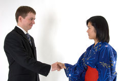 Young couple shaking hands Stock Photo
