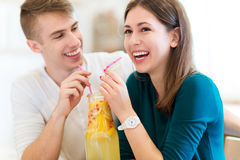 Young couple sharing a cocktail Royalty Free Stock Images
