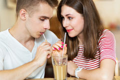 Young couple sharing a drink Royalty Free Stock Photography