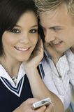 Young couple sharing headphones listening to MP3 player portrait close up Stock Image