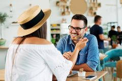 Young couple sharing meal in a cafe. - Image royalty free stock photography