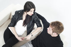 Young couple sharing on a sofa Royalty Free Stock Photo