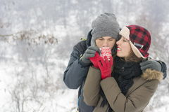 Young couple sharing tea outdoors in winter Royalty Free Stock Photos