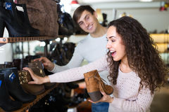 Young couple in a shoe store Royalty Free Stock Image