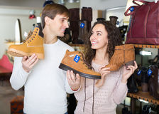 Young couple in a shoe store Royalty Free Stock Photo